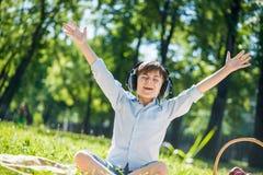 Boy enjoying music Royalty Free Stock Image