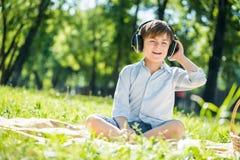 Boy enjoying music Royalty Free Stock Photo
