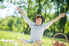 Boy enjoying music Stock Photography