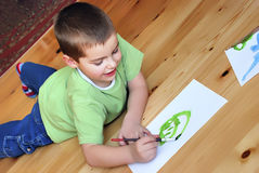 Boy enjoying in painting royalty free stock images
