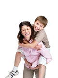 Boy enjoying piggyback ride on his mother's back Stock Photo
