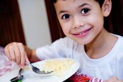 Boy enjoying plate of pasta Royalty Free Stock Image