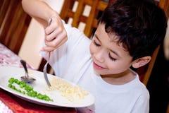Boy enjoying plate of pasta Royalty Free Stock Photos