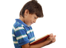 Boy enjoying reading a book Royalty Free Stock Photography