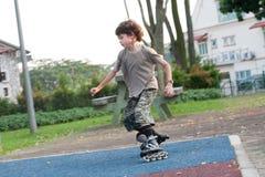 Boy enjoying rollerblading Royalty Free Stock Photos