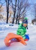 Boy enjoying a sleigh ride Royalty Free Stock Image