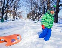 Boy enjoying a sleigh ride Royalty Free Stock Photo