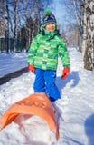 Boy enjoying a sleigh ride Stock Image