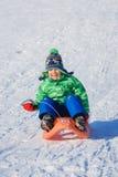 Boy enjoying a sleigh ride Stock Photography