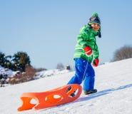 Boy enjoying a sleigh ride Stock Images