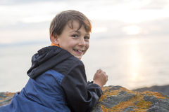 Boy enjoying the sunset side ocean Stock Photography