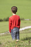 Boy enjoying view. Young boy enjoying view over green valley Royalty Free Stock Photography