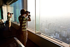 Boy enjoying view across Bangkok Stock Photo