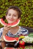 Boy enjoying watermelon Royalty Free Stock Images