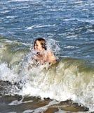 Boy enjoys the beautiful waves Royalty Free Stock Photos
