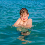 Boy enjoys the clear warm water Royalty Free Stock Images