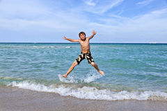 Boy enjoys the clear water in the ocean Stock Photos