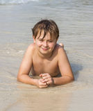 Boy enjoys his seaside holiday Stock Images