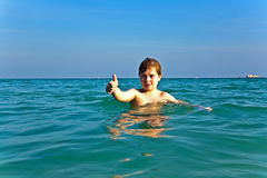Boy enjoys the ocean Stock Photo