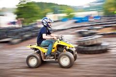 Boy enjoys Quad driving Royalty Free Stock Photo