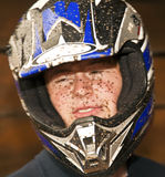 Boy enjoys Quad driving. Young boy is faszinated by qart driving and enjoyes is, his face is dirty from mud stock images