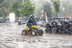 Boy enjoys riding his Quad at the parcour Stock Image