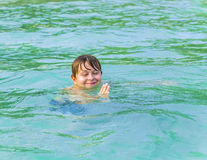 Boy enjoys swimming in the ocean Royalty Free Stock Images