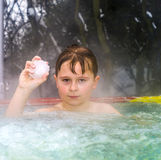 Boy enjoys swimming in the warm Royalty Free Stock Photography