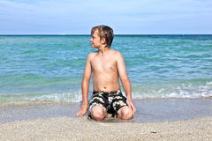 Boy Enjoys The Clear Water In The Ocean