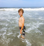 Boy enjoys the waves in the ocean Royalty Free Stock Images