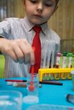 The boy enthusiastically studying chemistry Stock Image