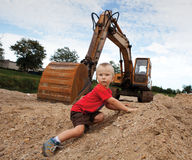 Boy and escavator Royalty Free Stock Photography