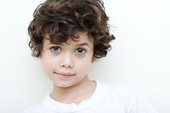 Boy of european and asian parentage smiles. Stock Photo