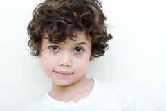 Boy of european and asian parentage smiles. Stock Photo