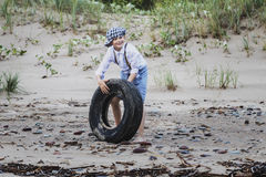 A boy in the evening at the tyre rolling Stock Photo