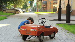Boy examines a toy car stock video footage