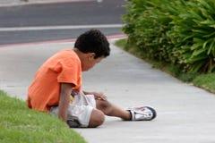 Boy examing his scab royalty free stock image