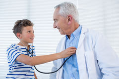 Boy examining the doctor royalty free stock images