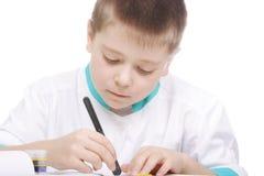 Boy examining object in lab Royalty Free Stock Photos