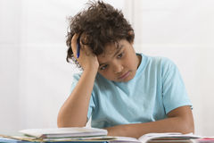Boy exasperated with his homework royalty free stock photography
