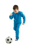 Boy executing a football kick Stock Image