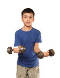 Boy exercise with dumbbells Stock Photo