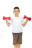 Boy exercising with barbell Royalty Free Stock Images
