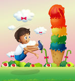 A boy exercising near the giant ice cream Royalty Free Stock Photo