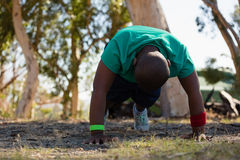 Boy exercising during obstacle course training Stock Photography