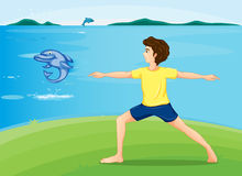 A boy exercising at the riverbank Royalty Free Stock Photography