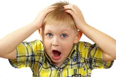 The boy  experiences emotions. Royalty Free Stock Photography