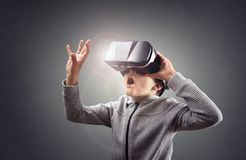 Boy Experiencing Using A Virtual Reality Headset Royalty Free Stock Image