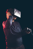 Boy experiencing virtual reality. On the black background Royalty Free Stock Image