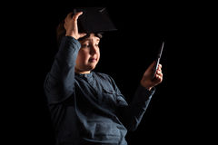 Boy experiencing virtual reality. On the black background Royalty Free Stock Photos